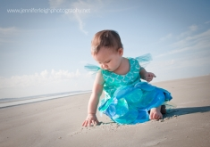 First Year - First Halloween Costume for Baby by Jennifer Tacbas of Jennifer Leigh Photography features images of a baby on the beach in a mermaid costume